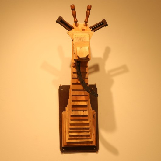 Solo Exhibition: Trophy Room. Giraffe made from found/recycled wood.