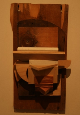 Solo Exhibition: Trophy Room. Abstract animal head made from found/recycled wood.